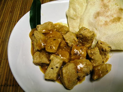 Spezzatino di maiale speziato con chapati