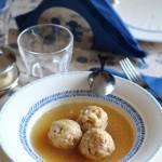Canederli in brodo alle erbe aromatiche con Parmigiano Reggiano e crudo di Parma